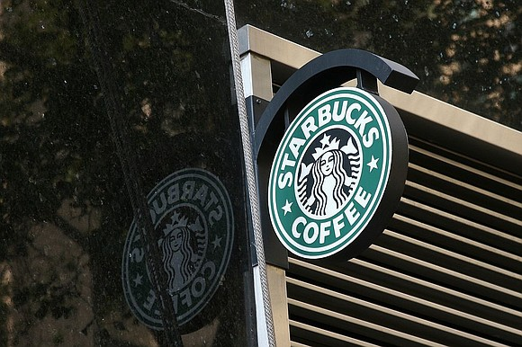 A recent report by a labor union suggests that the median pay for Black baristas at airport-based Starbucks locations is ...