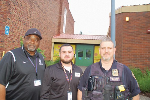 George Weatheroy and Ruben Nunez, representing security services for Portland Public Schools, and Sgt. Hank Hays of the Portland Police Bureau's Youth Services Division, were among a contingency of officers who went to King School Friday to investigate reports of racist intimidation, but nothing was found. It came two days after the multicultural Good in the Hood festival received death threats.