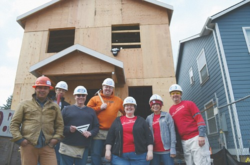 Wells Fargo employees have volunteered more than 130 hours so far this year to build 21 affordable homes in Portland's ...