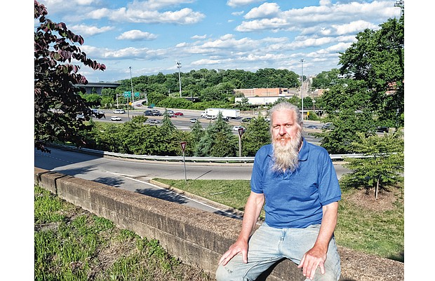 Daniel Kingery sits along Broad Street in Downtown, overlooking the 14th Street entry to Interstate 95, where he was arrested in April.