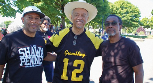 Community leaders Tony Hopson, Ron Herndon and Jerry Lawrence show their support for Good in the Hood. The 25th annual event was under tight security over the weekend after threats of racist violence, but thankfully none materialized.
