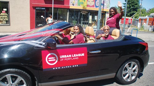 Urban League of Portland officials connect with parade onlookers on Northeast Martin Luther King Jr. Boulevard.