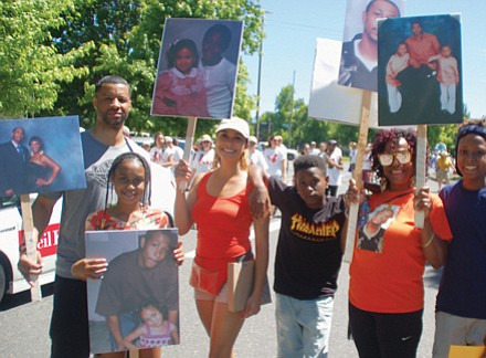 Lucy Mashia joins family and friends at Good in the Neighborhood to draw attention to unsolved cold cases, including the murder of her son L.J. Irving Jr. in 2011.