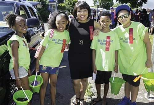 Multnomah County Commissioner Loretta Smith (center) greets Good in the Hood Parade participants Ariana Jenkins (from left), Alayah Ta, Jayden Ta and Kayden Taylor.