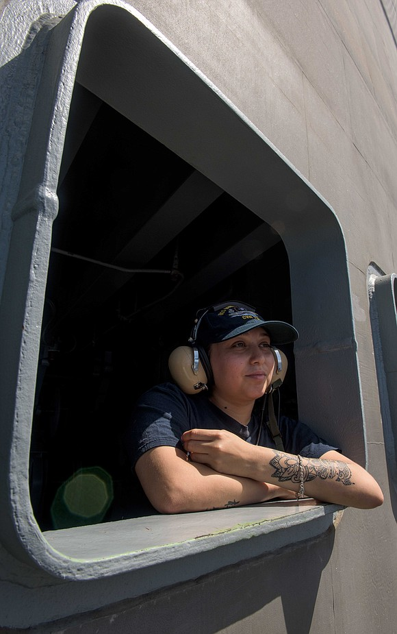 Seaman Natalie Herrera, from Houston, stands the fantail lookout watch aboard the Navy's forward-deployed aircraft carrier, USS Ronald Reagan (CVN ...
