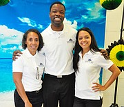 Jeremy Sherron (middle) and Everest Wellness staff at a client site. Sherron says there is a proven positive financial, cultural and emotional effect of implementing successful wellness programs.