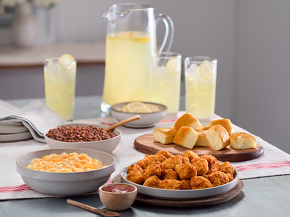 Chick-fil-A is rolling out family-style meals and two new sides — mac and cheese and bacon baked beans — in ...