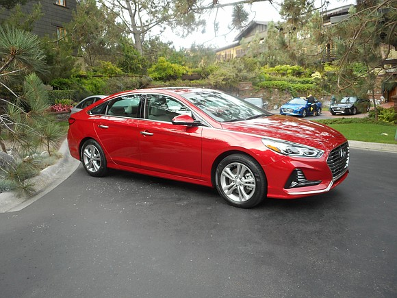 There was a 2018 Hyundai Sonata on display in front of the hotel here. We could tell it was a ...