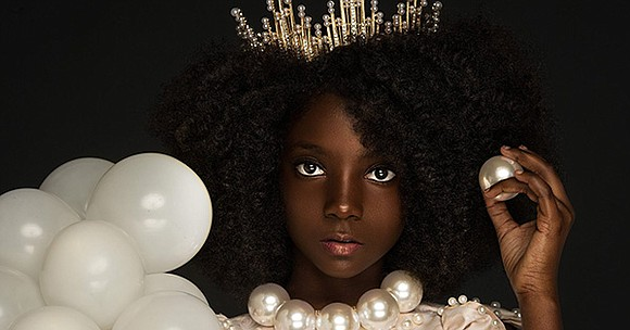 Kheris Rogers, a 10-year old girl who was being bullied for her darker skin, has turned the opportunity into a ...