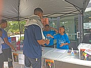 Snowball City team members serving customers