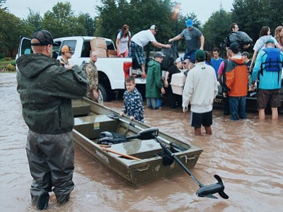 Corporate giants are making big contributions to disaster relief organizations to help victims of Tropical Storm Harvey.