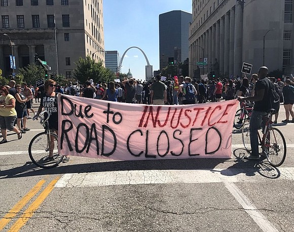 More than 80 people were arrested after a third night of demonstrations in St. Louis over the acquittal of a ...