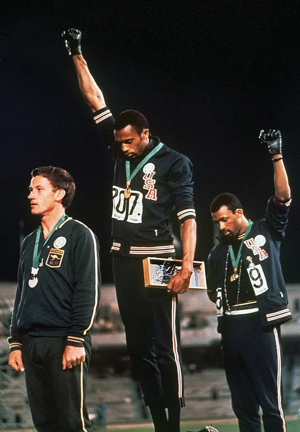 Like Mr. Smith and Mr. Carlos, Peter Norman, the silver medalist from Australia, wears a badge showing support for the Olympic Project for Human Rights.