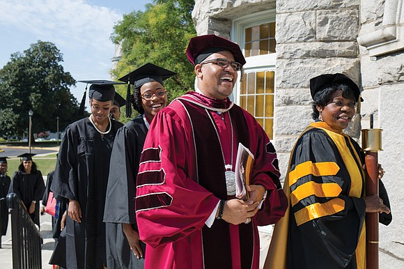 With bright sunlight streaming through stained-glass windows chronicling the 152-year history of Virginia Union University, Dr. Hakim Lucas, the university's ...