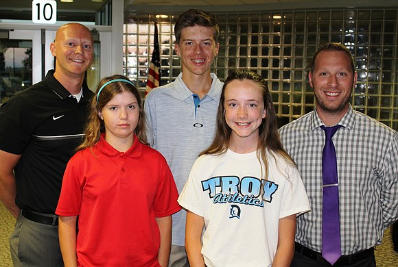 Four members of the Troy Community School District 30-C golf team qualified for the IESA State Golf Competition this year.