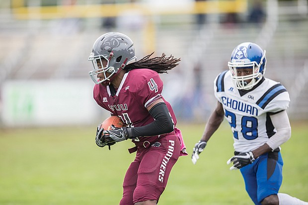 VUU's Chazton McKenzie, left, carries the ball Saturday with Chowan's Bryan Bryant in close pursuit.
