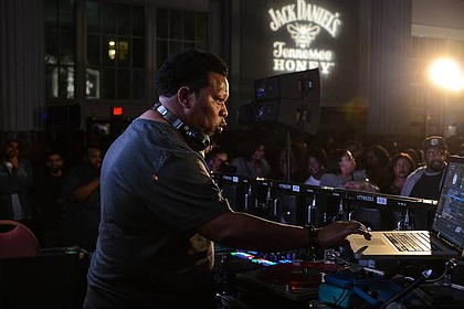 Legendary hip-hop producer and DJ, Mannie Fresh, shows off  his skills on the one's and two's in front of a packed house at the Art, Beats and Lyrics event in Houston.  Presented by Jack Daniel's Tennessee Honey, Art Beats and Lyrics showcases some of today's best upcoming artists, along with seasoned veterans in art and music under one roof. For information on Art, Beats and Lyrics please visit www.JackHoneyABL.com. (Photo by Kat Goduco/AB+L)