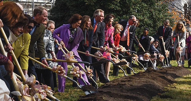 Gov. Terry McAuliffe, center, and his wife, First Lady Dorothy McAuliffe, to his right, are flanked by former Virginia first ladies Lynda Bird Johnson Robb (in purple) and Susan Allen (in pink) as they break ground Monday for the monument in Capitol Square that will honor women's roles in Virginia's history for more than 400 years.