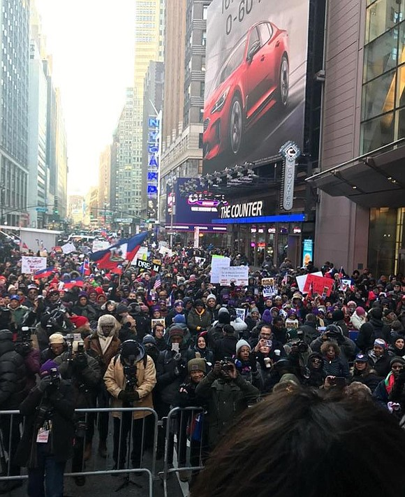 Hundreds of people assembled in Times Square on Martin Luther King Jr. Day to protest racist statements made by President ...