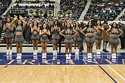 The Virginia Union University Rah Rahs work to rally Panthers fans with cheers from the sidelines.