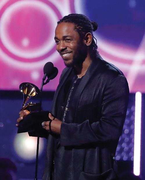 "Below, Kendrick Lamar accepts the Grammy for best rap album for ""DAMN."""