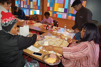 Hughes Memorial United Methodist Church volunteers prepare sandwiches every fourth Saturday of the month for donations to the homeless. The northeast Portland church hopes to expand the effort to as much as weekly in the future.