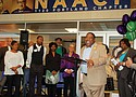 A historical Portland Observer photo shows celebrants and community members joining Portland NAACP President and Pastor E.D. Modainé for the 2018 grand opening of a new NAACP office and headquarters in Lloyd Center.