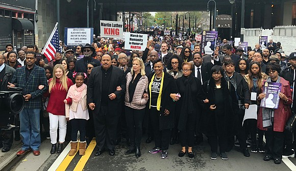Relatives of Dr. Martin Luther King Jr. led more than 1,000 people on a march Monday in downtown Atlanta, where ...