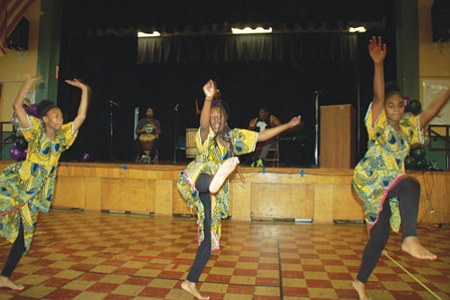 "West African dance is performed by students from Martin Luther King Jr. Elementary School during a ""Celebrate the Legacy"" event honoring the tenants of social justice and equality."