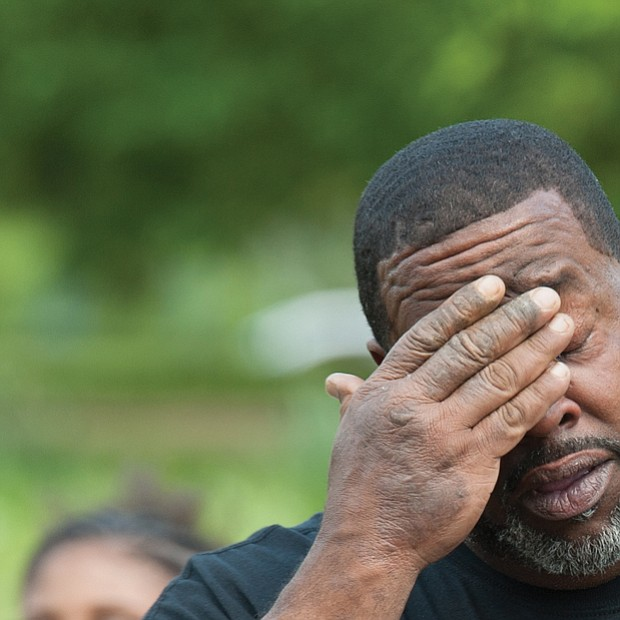 Holding on to hope // Brian Hunt, the father of Delecia Waddy, 24, who has been missing from Bowling Green since March 9, 2017, tries to gather himself, below right, during an emotional Richmond Missing Persons Day Rally last Saturday at Chimborazo Park.