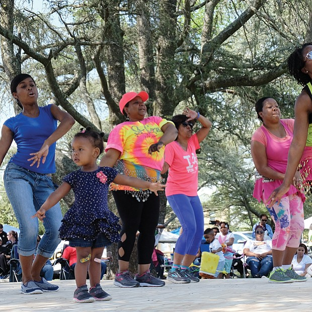 Above right, high steppers from Kickin' Country show off their moves, while Zumba instructor Tasha King, left, leads a group, including 2-year-old Gabriella Johnson, front left, in a demonstration of the exercise dance.