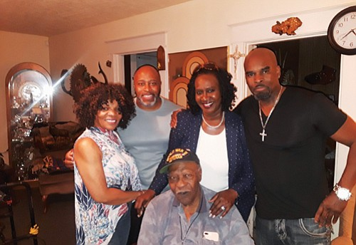 George Kelly of Portland (seated, center) celebrates his 94th birthday with his family and friends, including (pictured from left) Brenda ...