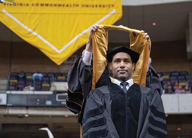Actor Boris Kodjoe, a Virginia Commonwealth University alumnus and athletics hall of famer, receives an honorary degree after delivering the commencement speech during Saturday's ceremony.