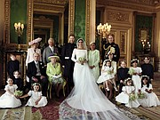 The new royal family as seen in the official wedding photograph taken in the Green Drawing Room at Windsor Castle and released Monday by the newlyweds. Surrounding the newlyweds, Prince Harry and Meghan Markle, the Duke and Duchess of Sussex, they are back row, from left: Jasper Dyer; Camilla, the Duchess of Cornwall; Prince Charles, the Prince of Wales, the groom's father; Doria Ragland, the bride's mother; and Prince William, the Duke of Cambridge, the groom's brother. Middle row, from left: Brian Mulroney; Prince Philip, the Duke of Edinburgh, the groom's grandfather; Queen Elizabeth II, the groom's grandmother; Catherine, the Duchess of Cambridge, with Princess Charlotte on her lap; Prince George; Rylan Litt; and John Mulroney. Front row, from left: Ivy Mulroney, Florence van Cutsem; Zalie Warren; and Remi Litt.