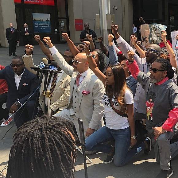 Civil rights groups and community leaders served up a message of defiance outside NFL headquarters in Midtown Friday.