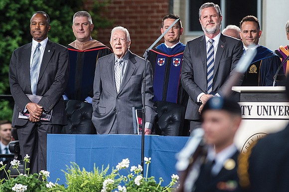 Former President Jimmy Carter took a gentle poke at President Trump at the start of a commencement address to graduates ...