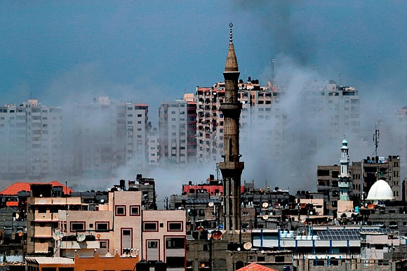 Israel has carried out dozens of airstrikes on targets in Gaza in response to what it called the biggest barrage ...