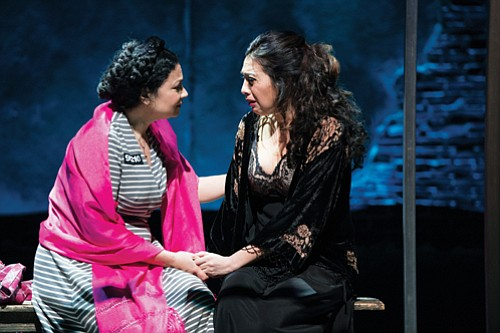 """Pilar Esperanza Castillo (Esperanza America, right) shares a jail cell with Hortencia Del Rio (Adriana Sevahn Nichols), the woman she believes to be her maid in """"Destiny of Desire,"""" a story about female empowerment running through July 12 at the Oregon Shakespeare Festival in Ashland."""