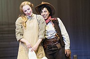 """Curly (Tatiana Wechsler, right) tries to entice Laurey (Royer Bockus) into accompanying her to the box social in """"Oklahoma,"""" a LGBTQ+ focus production now showing through Oct. 27 at the Oregon Shakespeare Festival."""