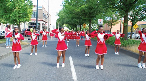 King Middle School Lions Drill Team marches down Northeast Martin Luther King Jr. Blvd for the annual Juneteenth celebration.