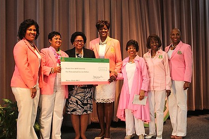 Alpha Kappa Alpha Sorority, Inc. International President Dorothy Buckhanan Wilson and other members presents $10,000 donation to Prairie View A&M University President Dr. Ruth Simmons/photo Senora Webster