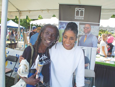 City Council candidate Jo Ann Hardesty greets Chonitia Smith at the Good in the Hood festival grounds.