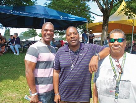 Otha Tyler (from left), Alex Spearman, and Glenn Harper enjoy Good in the Hood festivities at Martin Luther King School Park.