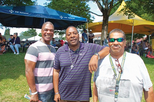 Otha Tyler (from left), Alex Spearman, and Glenn Harper enjoy Good in the Hood festivities at Martin Luther King School Park.
