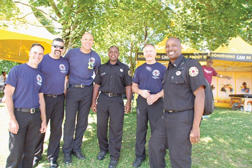 Local firefighters Brent Sheldon (from left), Eric Mann, Damon Simmons, Sultan Shabazz, Pete Straub, and Ted Mayes, enjoy the festivities.