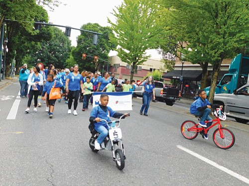 Young people march in the Good in the Hood Parade in conjunction with Legacy Emanuel Hospital.