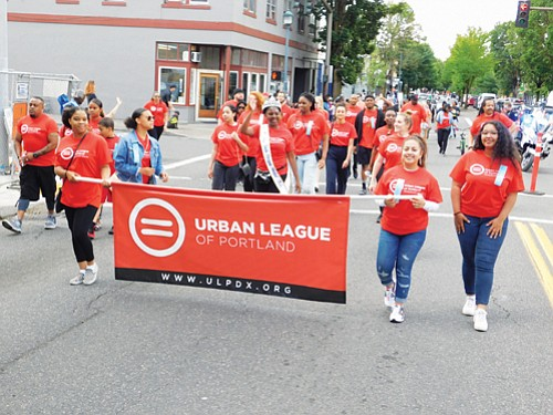 A large group represents the Urban League of Portland at Saturday's parade.