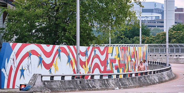 A long, colorful mural now decorates the eastern portion of the Martin Luther King Jr. Memorial Bridge in Richmond that faces the middle school that also bears the name of the civil rights giant.