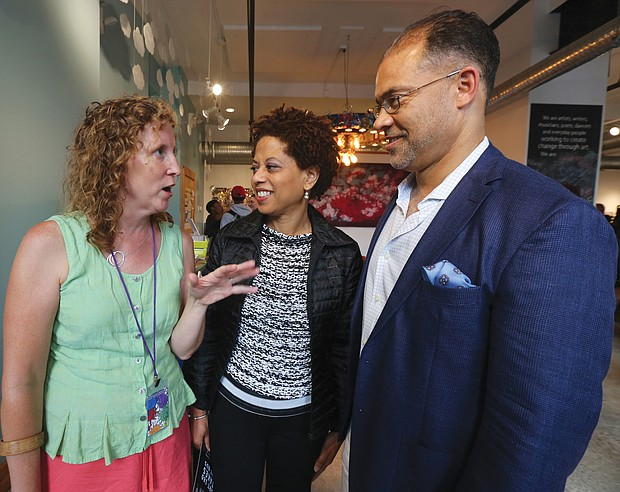 """Marlene Paul, left, ART 180's co-founder and executive director, greets Melody Barnes, former White House domestic policy adviser, and her husband, Marlon Buckner Jr., at the opening of ART180's 20th anniversary exhibit last Friday at the organization's Atlas Galley, 114 W. Marshall St. Work from the exhibit, titled """"Twenty: ART 180 Takes the Bus,"""" will spend most of August touring the city on GRTC buses."""