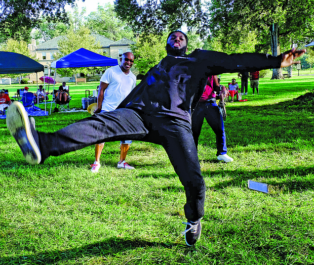 "Christopher Woody amazes the crowd with his dance moves and death drop Saturday at the 3rd Annual RVA Soul House Fest held at St. Joseph's Villa. The free event, a community party, featured six DJs and a host of entertainers serving up a variety of ""house music,"" a mix of soul and R&B."
